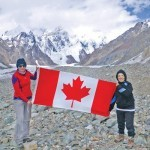 North Shore doctor Shehla Ebrahim raises the Canadian flag